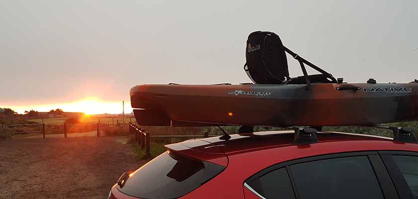 Slayer kayak mounted to roof racks